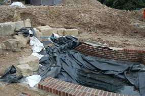 A Hampshire pond during construction to a garden design by Martyn Gingell