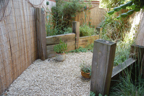 Groynes and gravel in a tight corner of a Hampshire garden designed by Martyn Gingell